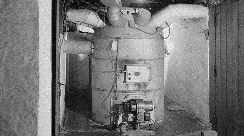 An old furnace in a basement