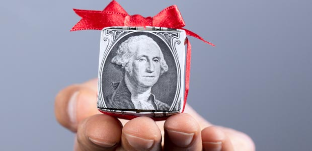 A dollar topped with a red bow