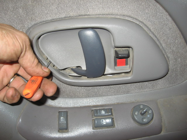 How Do You Remove The Door Panel Of A 1998 Gmc To Fix The