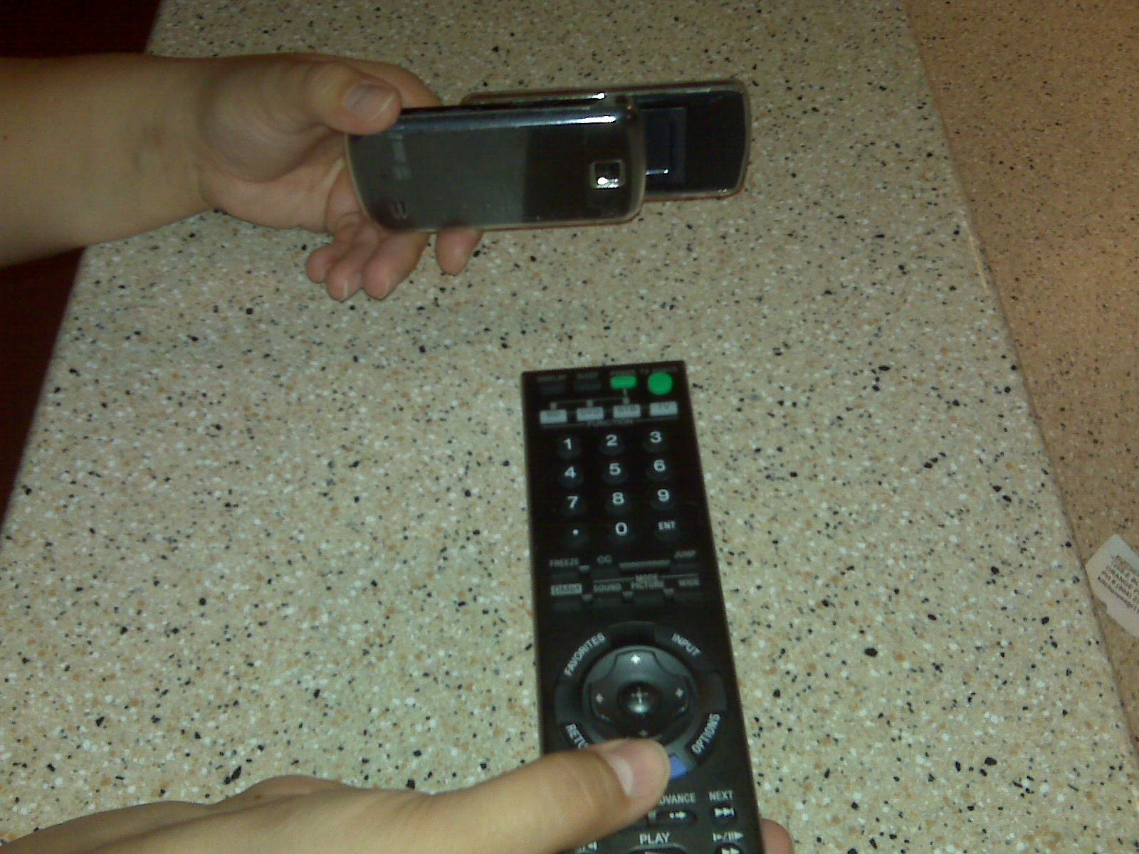 how to change the battery on the bravia remote