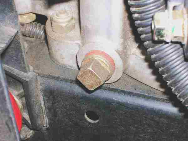 Oil Plug Close on Engine Block Coolant Drain Plug