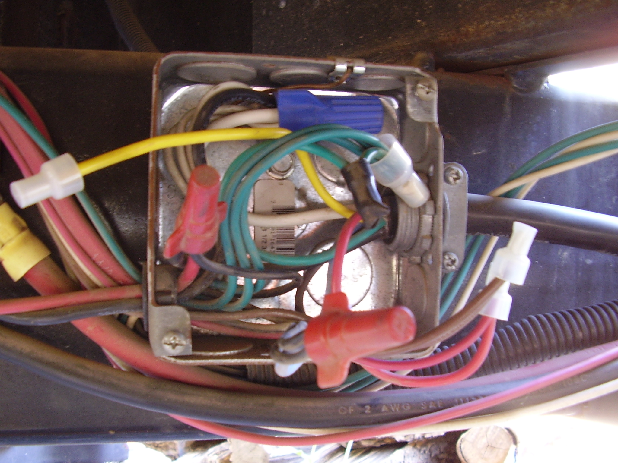 we have a 2010 puma palimino 5th wheel the wire harness that at the top of the box the bundle of white wires has a black lead in it that is also a ground lead it is not coming from the 7 way cord