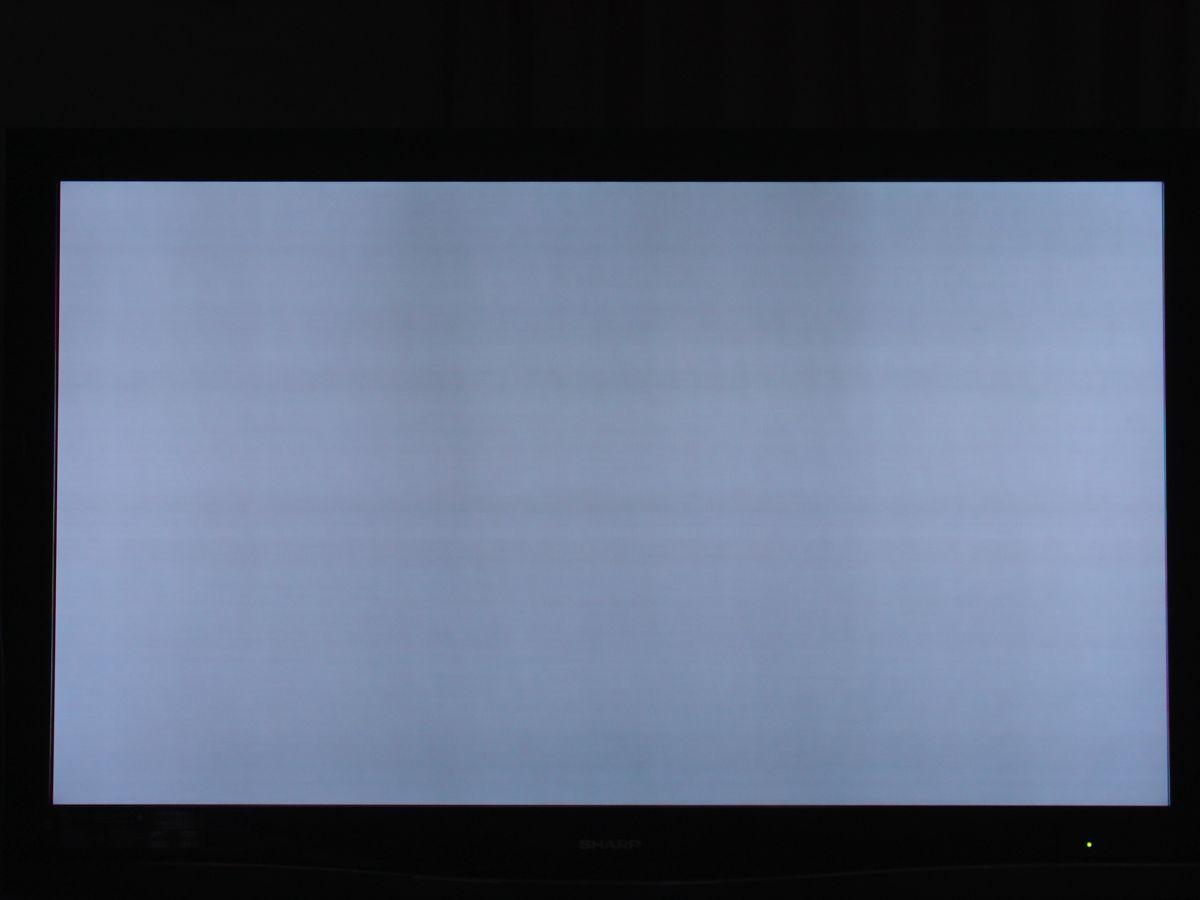 Samsung tv has dark shadow on right side of screen, present