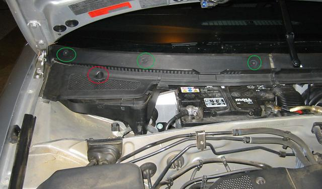 where is the battery located for a 1997 audi a4
