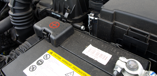 A typical car battery with positive and negative nodes