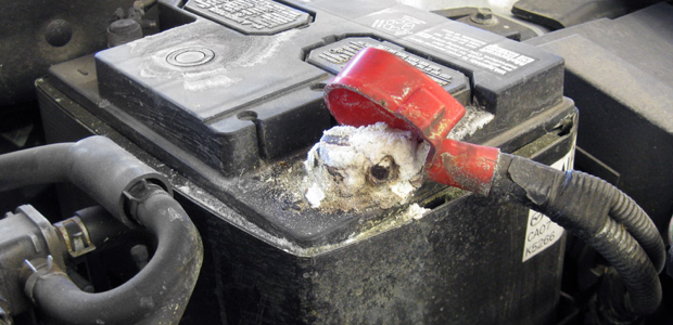 A car battery with evidence of corrosion