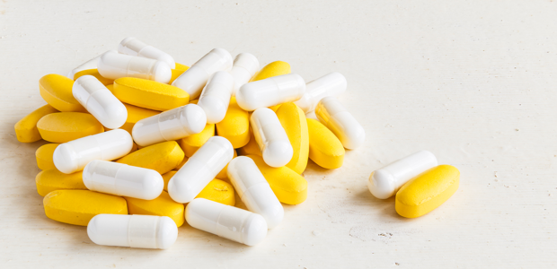 A small cluster of white and yellow pills