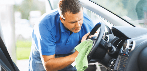 Cleaning the steering wheel of a car a lessee is returning