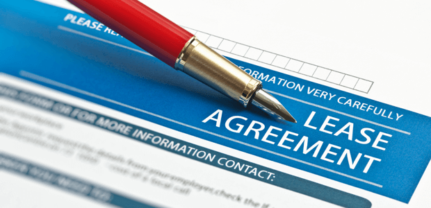 A lessee signing a lease agreement